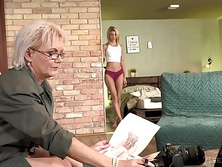 Sexy GILF photographer having sexual intercourse with a pretty young woman
