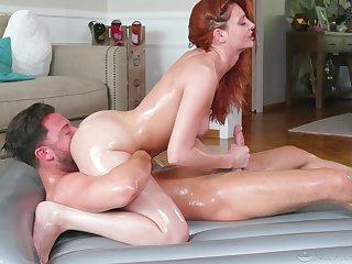 Stunning redhead Lacy Lennon fucked balls deep during a Nuru massage