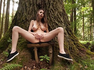 Aroused girl with broad in the beam naturals, seductive solo into the woods